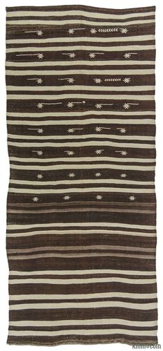 Vintage striped kilim rug handwoven with undyed wool in Turkey in 1960's. This tribal modernist rug is in very good condition. It is perfect for both contemporary and bohemian settings.