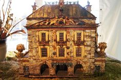 This miniature house is made entirely from sticks and bark. Incredible!