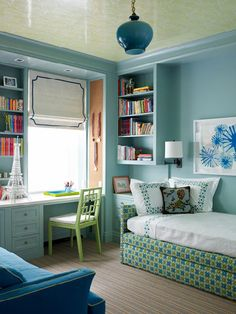Love this turquoise and green girl's bedroom. The built-in bookcases, Roman shade and ceiling detail are the best. Designed by Katie Ridder.