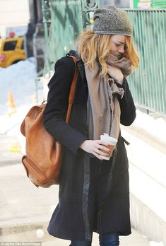 Cover up! The 25-year-old shielded her face with her beige scarf