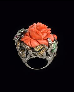Coral Diamond Flower Ring Lydia Courteille Collection Coral centerpiece in black gold, surrounded by diamonds, garnets, rubies and sapphires