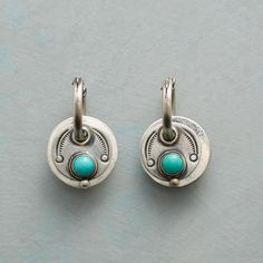 """SANTA FE SUN EARRINGS--Dennis Hogan's love for the West comes through in sterling silver earrings with handstamped disks and touches of turquoise. Sterling silver wires. USA. Exclusive. 1""""L."""
