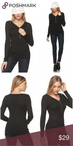 Front zipper must have black basic top! A modern twist in a must have basic long sleeve v-neck knit top with front zipper in a perfectly form fitting stretch fabric. 80%Rayon 20%Nylon- Machine wash. Tops