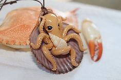 Gold Octopus inside a seashell/pendant necklace jewelry/ handmade/ polymer clay