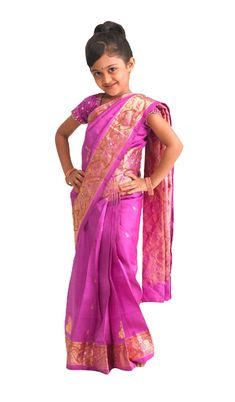 Let your little girl step out in style in this lively bright pink silk saree, designed with sparkling borders adorning the body. This creation is sure to make all the other kids and parents gape in astonishment at how beautiful and confident she looks. $88.28