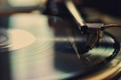Vintage record player and vinyl records - That moment when the needle hits the vinyl...