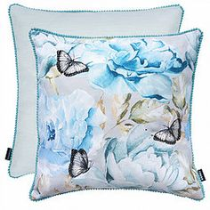 Update your sofa with this beautiful luxury feather filled cushion for a wonderful look and feel. It features a floral Printed design with an overlay of embroidered butterflies. The edges are elegantly beautified with pom poms.  CARE AND INFO      100% Polyester    Size - 43cm x 43cm