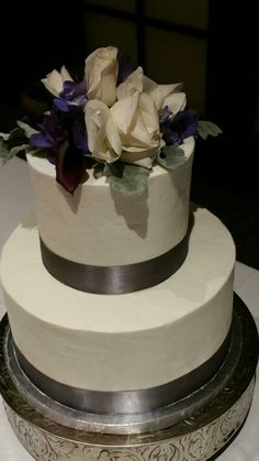 Fresh floral topper and silver satin ribbon accent the smooth butter cream frosting. Specialty Cakes, Buttercream Frosting, Wisteria, Wedding Cakes, Floral, Wedding Stuff, Desserts, Cupcake, Smooth