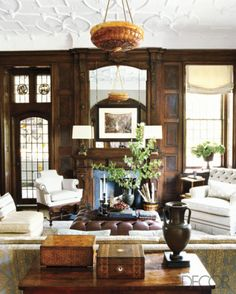 The antique mantle, mirror, and stained-leaded glass are just beautiful!