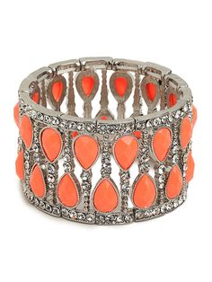 Indulge in the all-out glamour of this gorgeous statement cuff. It features a glitzy mix of ice-white crystals accented with colorful gemstones, each chicly faceted and framed in twisted silver.