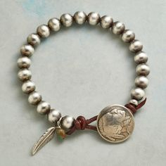 """INDIAN HEAD NICKEL BRACELET--Handmade in the USA and sporting a button borne of a genuine Indian Head Nickel, our sterling silver beaded bracelet blends old and new with uncommon style. Turquoise bead. Leather loop. USA. Exclusive. 8-1/2""""L."""