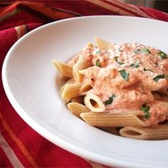 Tomato-Cream Sauce for Pasta - Allrecipes.com  Add 1 1/2 packs tortellini and almost a pound of chopped sausage.