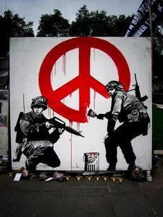 Banksy...How appropriate to render the peace sign to appear as if dripping in blood!