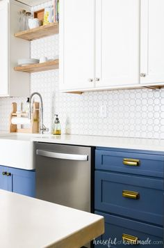 See how we created a beautiful two tone kitchen with loads of farmhouse charm. The blue and white two tone kitchen cabinets add instant style to the space. Two Tone Kitchen Cabinets, Cheap Kitchen Cabinets, Farmhouse Kitchen Cabinets, Kitchen Cabinet Design, Upper Cabinets, Base Cabinets, Kitchen Backsplash, New Kitchen, Kitchen Decor