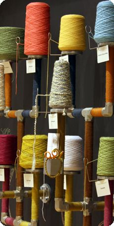 """Yarn samples at the Lion Brand store in NYC--you can """"sample"""" a few yards of the different yarns and they let you work with them in the studio to see how you like them :)"""