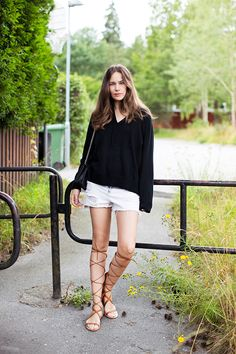 Cutoffs with a comfy knit + lace-up gladiator sandals.