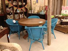 Waxed Tiger Oak Pedestal Table and Turquoise Wicker Chairs