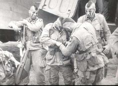 101st paratroopers helping eachother.