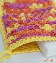 This is a fantastic beginner pattern! If you can sc and dc, you can make this bath mitt. The PSC stitch is super easy, and gives an amazing texture - video and photo tutorial included! The Pampering Picots Bath Mitt is a wonderful pattern for new crocheters to make for holiday gifting!