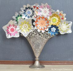 How to create a bouquet of flowers with aluminum light reflectors, buttons, and other tidbits. From MySalvagedTreasures.com