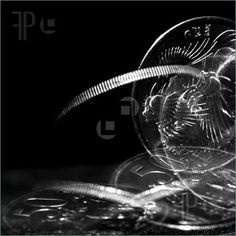 Photo Of Spinning Coin -- Royalty Free Image at FeaturePics.com