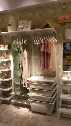 Ikea Algot built in wardrobe with fun wall paper behind it