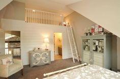 Love the cool dresser, and the loft!!!  Olentangy Falls ~ Delaware, OH modern bedroom  Parade Home