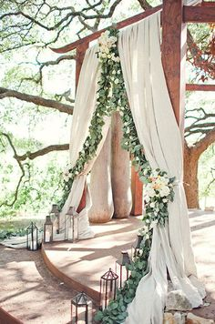 Green ivy lines cream linen to create a rustic altar. Altar, Wedding Decorations, Chuppas, Flowers