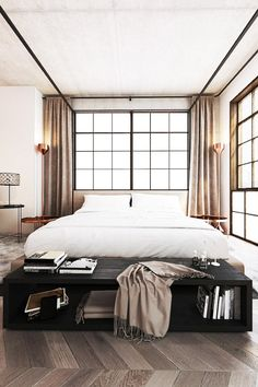 Minimalist bedroom with bronze lamps, floor to ceiling curtains, and a black bench