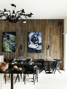 Moooi chandelier, reclaimed wood planks, Tom Dixon slab chairs, Dinesen Douglas floor