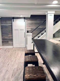 A HGTV fixer Upper basement remodel with shiplap wood walls, sliding barn doors, and industrial chic accents. Source by ohclarks The post A HGTV fixer Upper basement remodel with shiplap wood walls, sliding barn doors,& appeared first on Wise Cabinetry. Rustic Basement, Modern Basement, Basement House, Basement Stairs, Basement Bathroom, Basement Ceilings, Small Basement Design, Cozy Basement, Cool Basement Ideas