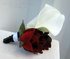 This white calla boutonniere is designed with a real touch calla lily & velvet red rose, black satin ribbon wrap with a white satin sash. Great for weddings or proms, this calla boutonniere is the perfect finishing touch for any formal look. Coordinating Brides bouquet: http://brideinbloom.indiemade.com/product/baccara-rose-calla-lily-wedding-bouquet-black-red-white-silk-bridal-flowers