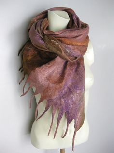 Hand felted scarf made with merino wool and a lot of silk. Cobweb felt is lightweight, warm, soft and lacy, holes are part of the work technique.