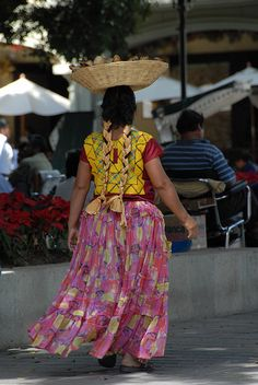A Zapotec woman from the Istmo of Tehuantepec sells flowers in the zocalo of Oaxaca Mexico