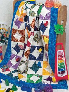 Free Pocket Pinwheel Quilt Pattern -- Download this free baby quilt pattern from Freepatterns.com.
