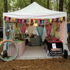 This market stall has a clear identity. The colourful scarfs work well with the bright bunting