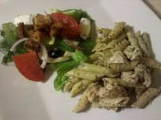 Pesto Penne Pasta w/Grilled Chicken and Salad Topped w/Homemade Herb Croutons and a Rice Wine Vinaigrette.