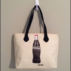 Coca-Cola Tote Bag Adorable Coca-Cola bag!  Double strap.  Zippered closure.  Rear zippered pocket.  This bag was a display model and is dingy/has discoloration in some areas (see pics for examples).  Dimensions will be posted soon. Coca-Cola Bags