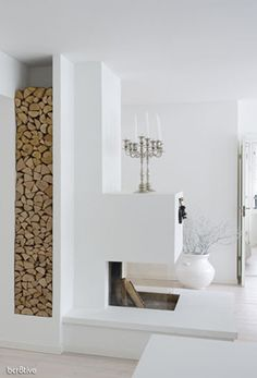 White Scandinavian Home - I love the cubby for firewood -