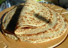 Staffordshire Oatcakes - Perfect for our Olympics watching morning breakfast! Served savory with devon double cream and bacon. Doubled the recipe for plenty of leftovers.