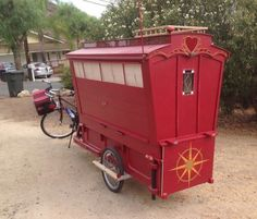 Living in a shoebox     Artist built a micro gypsy wagon you can tow with your bike
