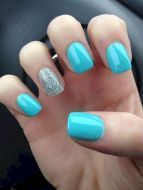 Two tone nails are very popular nowadays. You must have seen many models and celebrities show off beautiful manicured nails with the coolest two tone nail designs on them. As the name suggests, two tone nails art means that the wearer uses two differ Blue Glitter Nails, Light Blue Nails, Blue Acrylic Nails, Acrylic Colors, Silver Glitter, Turqoise Nails, Glitter Art, Sparkle Nails, Acrylic Art