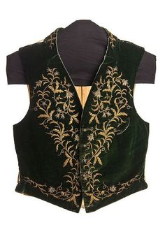 Man's green velvet vest, c. 1830. Gold and silver thread embroidery creates a stunning floral vine. Throughout the 19th century, men wore elaborate vests as a matter or style and fashion. This vest was worn by William Seabrook (1799-1860), son of Sea Island cotton magnate, William Seabrook and Mary Ann Mikell. From the collections of the Charleston Museum, Charleston, South Carolina.