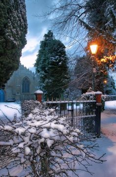 Looks like a Thomas Kincaide painting:  Cottingham, the East Riding, Yorkshire, England. A light glows in winter.