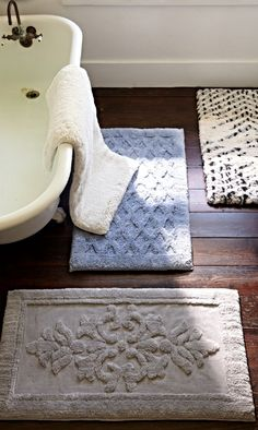 "Step out of the shower onto nearly 2"" of ultra-soft decadence with the Solid Removable Memory Foam Bath Rug.  