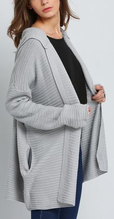 Enjoying the look and comforting feel of this loose knit cardigan//
