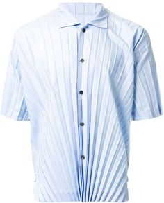 Light blue pleated short sleeve shirt from Homme Plissé Issey Miyake.