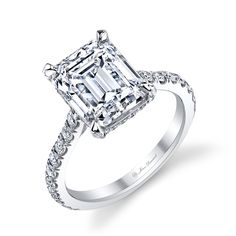 In love with this one!!! Emerald Cut Diamond Engagement Ring set in Platinum with white pave-set diamonds by Jean Dousset