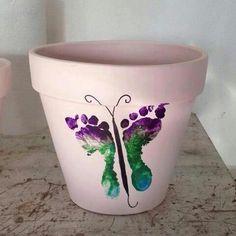 Butterfly footprint painted Mother's Day flower pot DIY art craft.