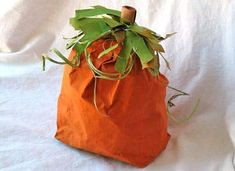 This paper bag pumpkin is easy to make and fun for kids. A great decoration or a party bag for treats to take home from a fall party!